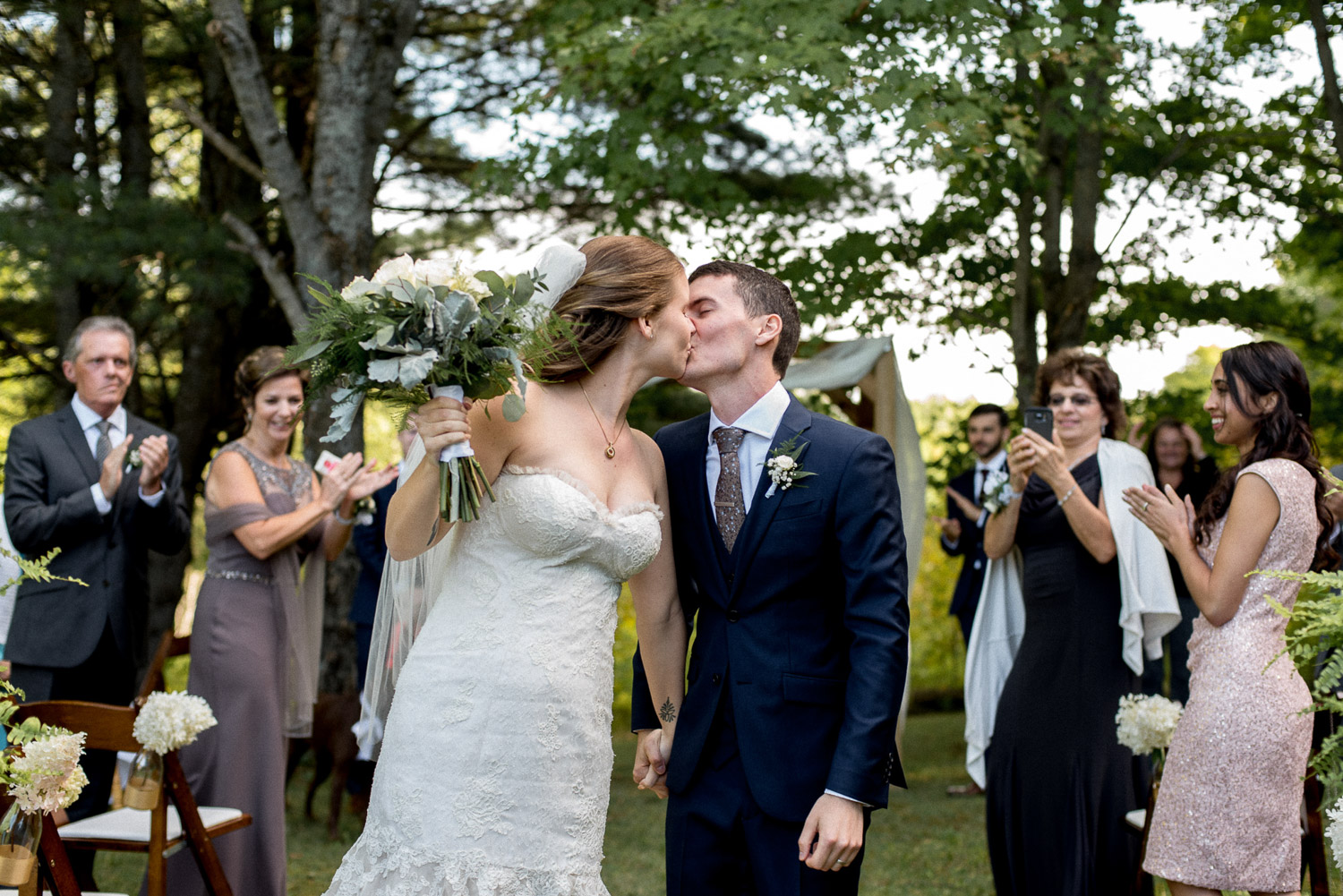 newlyweds kissing at Ontario cottage wedding