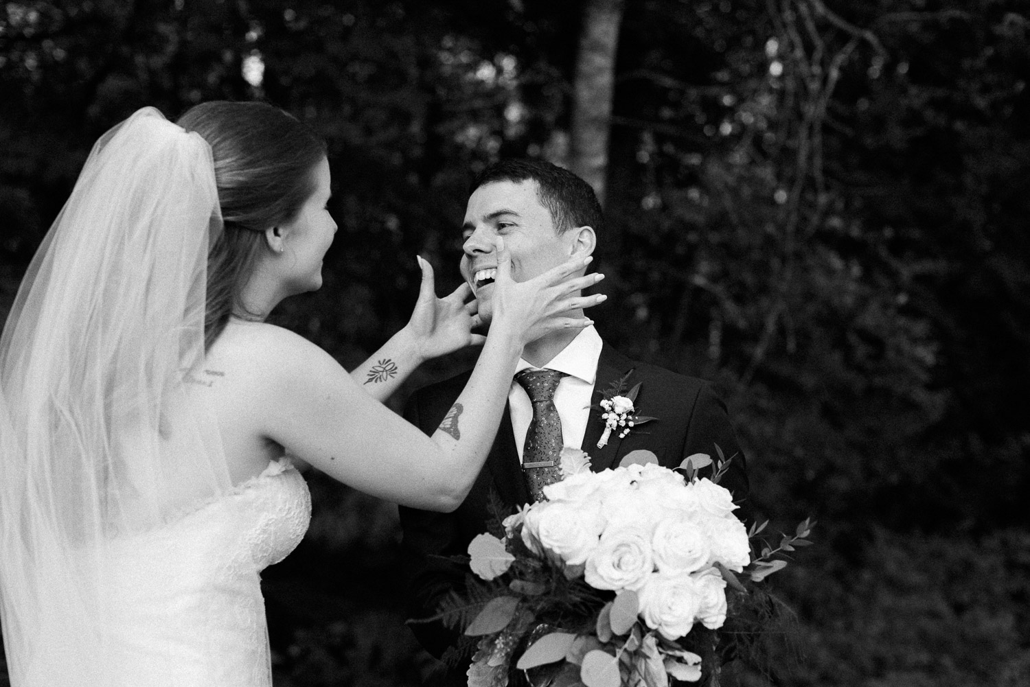 happy couple about to kiss at their ontario cottage wedding
