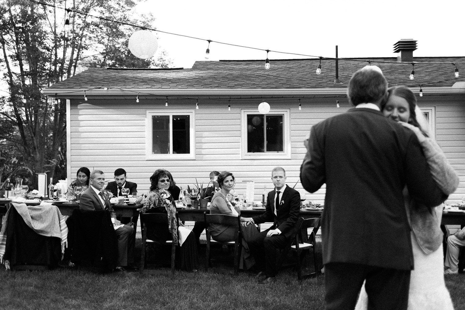 guests watching bride dance with dad