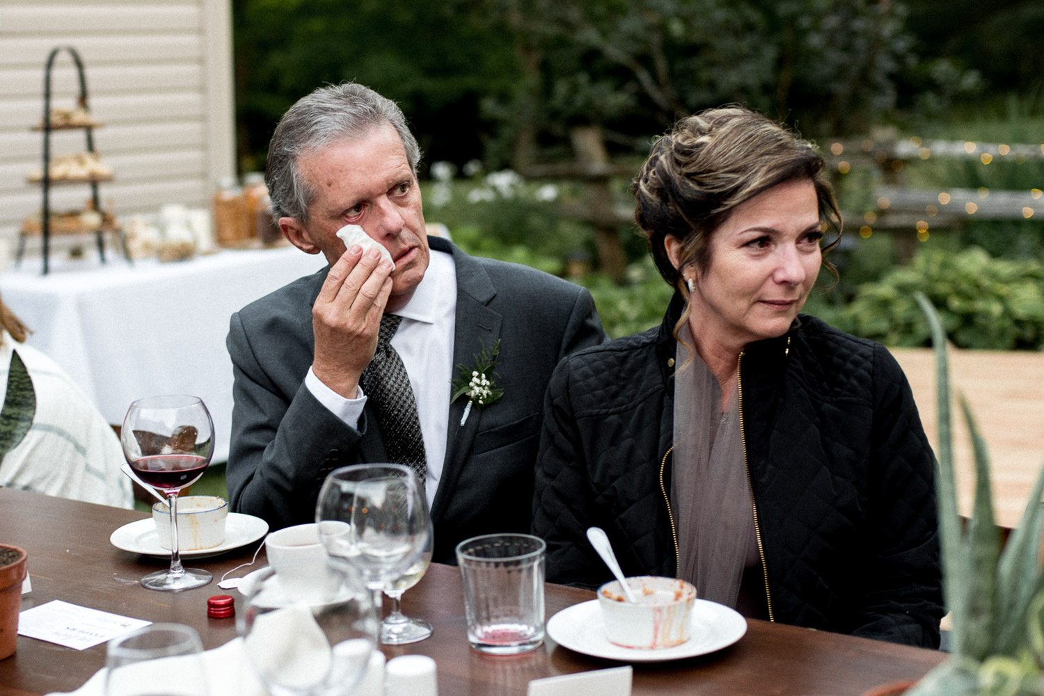 parents crying during wedding speech